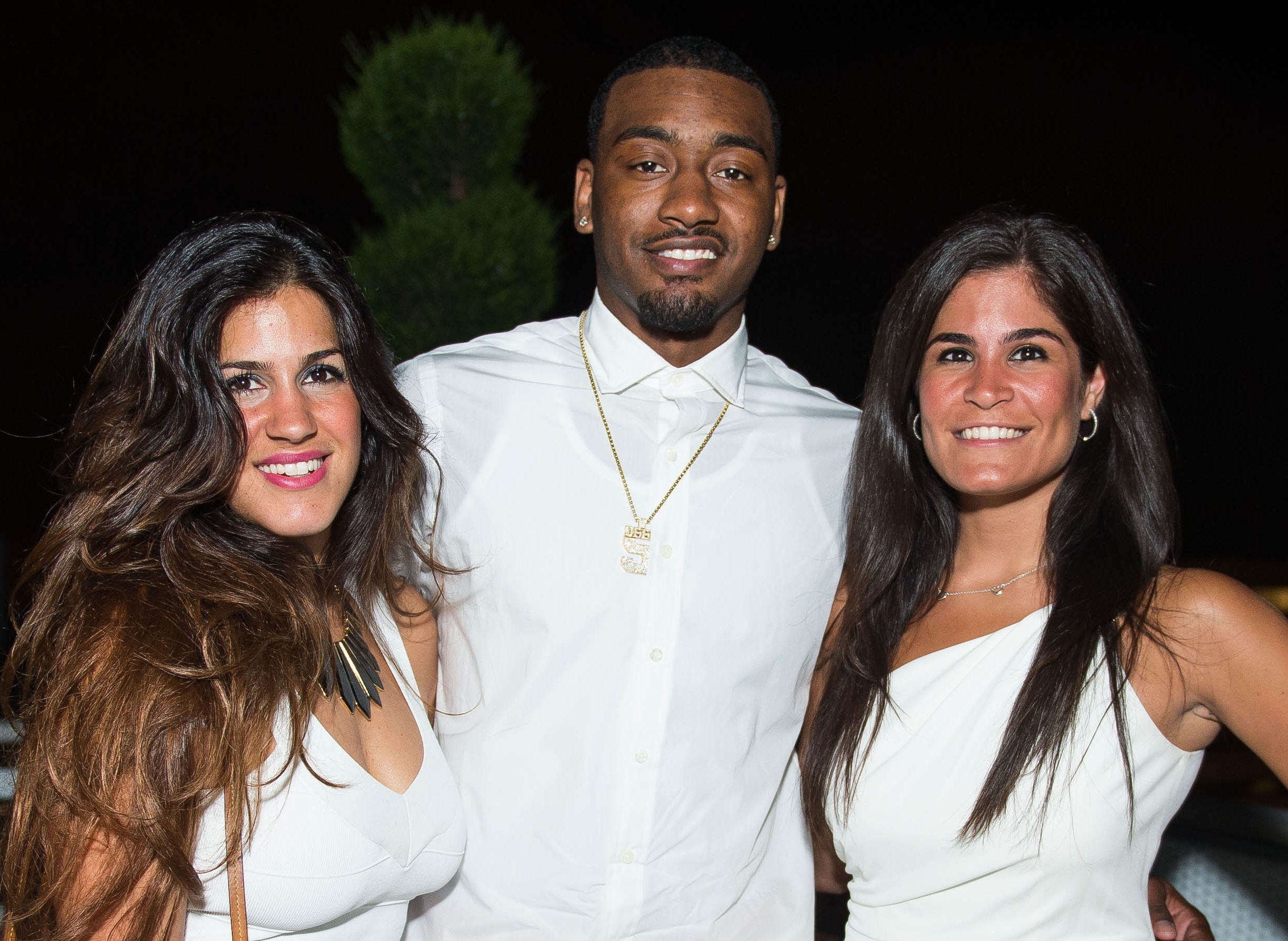 MoKi Media Dannia Hakki and Maha Hakki surround Washington Wizard John Wall by Joy Asico