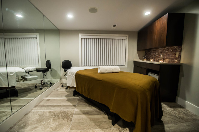 Four treatment rooms play home to massage and facial services at Luigi Parasmo Salon's new spa by Joy Asico