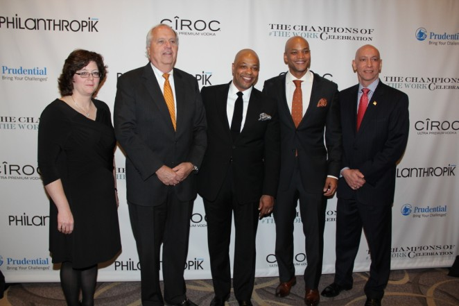 Prudential's Mary Rood and Mark Grier, Robert Clark, Wes Moore and Prudential's Chuck Sevola